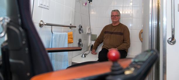 Man sitting on a bathtub.