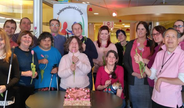photo of various members of the VDRC wearing pink and holding pink roses for pink day.