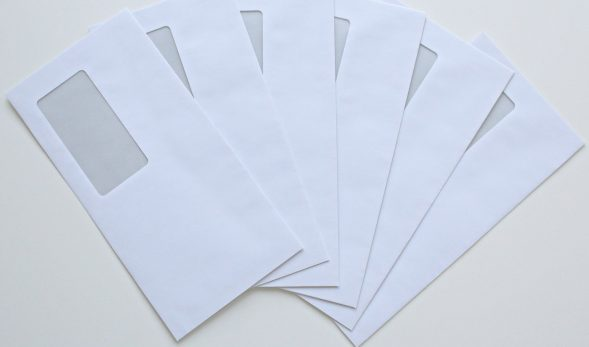 Photo of six blank envelopes, laid out as to see all of them easily.