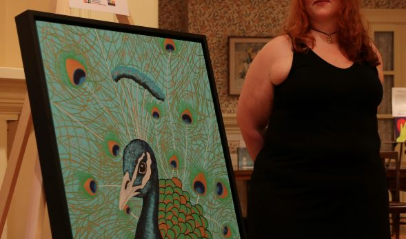 "Picture of Megan JL Evans with her art piece ""The Close-Up"""