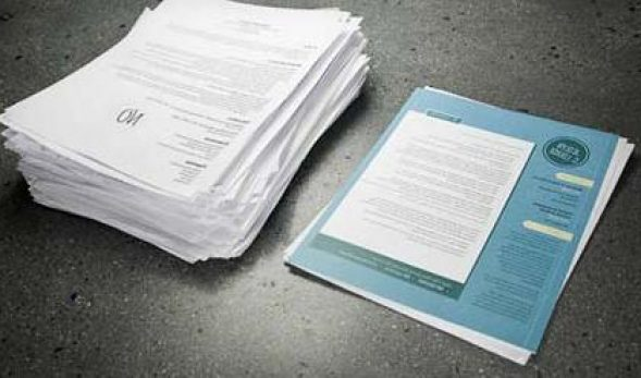 Photo of two piles of resumes, one rejected and one accepted.