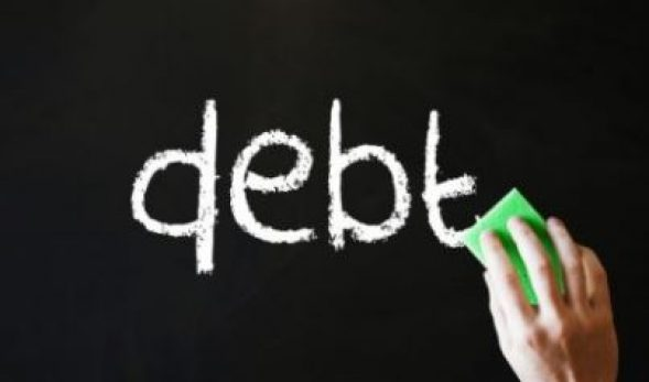 "Graphic of a hand with an eraser preparing to erase the word ""debt"" from a blackboard."