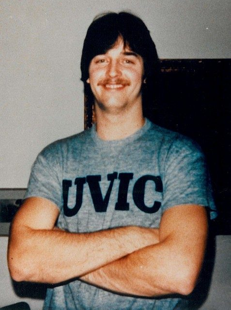Young Neil Squire standing with UVIC tshirt